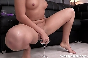 This youthful slut just loves to piss